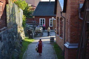 Skansen's staff dress up like craftsmen in historical clothes such as bakers